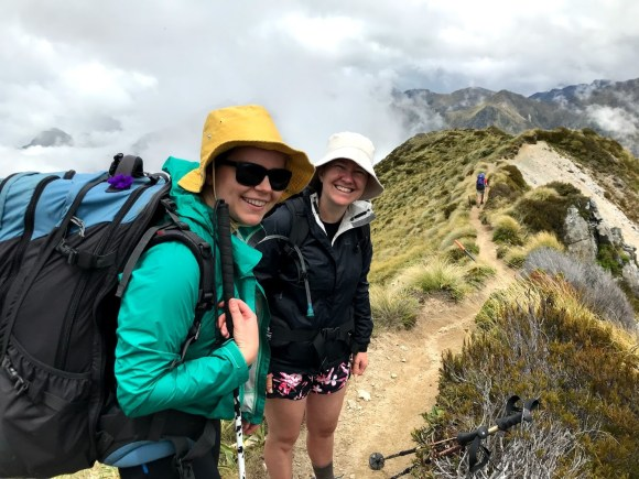 Mary and Becky in their sunhats going along the last bit of the ridge before the mega-downhill.