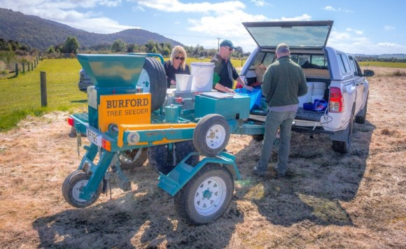 DOC's Sue and Tim with Mark from the Waiau Trust (centre) preparing seed mixes.