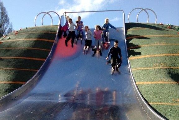 Kids on the slide at Margaret Mahy Park.