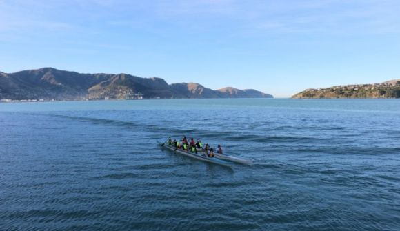 Waka being used to ferry people to Ōtamahua / Quail Island.