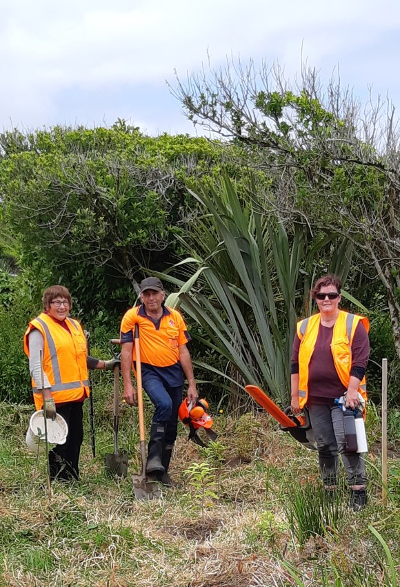 Some of the volunteers after a long, hot working bee. Left to right: Trish Creagh, Kevin Cohen, and Fran Cohen who is also DOC Greymouth's very own business support officer. Photo by Wendy Ross