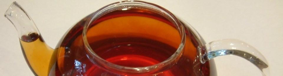 Glass Teapot with Amber Colored Tea Liquor