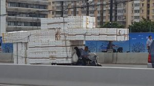 Moped covered in Styrofoam boxes.