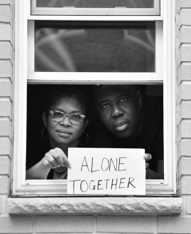 Ditmas Park, Brooklyn, New York: Part of a photo project in which people are standing at windows while holding signs with quarantine-inspired messages, by Stephen Lovekin