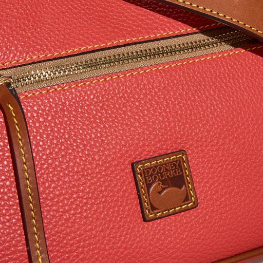 close up of dooney & bourke logo on pebble leather