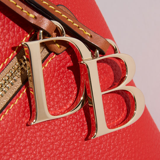 close up of pebble grain leather bag with monogram pendant