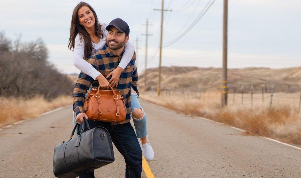 Josie Lynn and her boyfriend embracing and holding D&B handbags.
