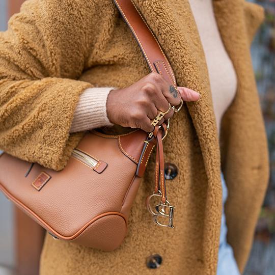 Britney Turner wearing our Pebble Grain shoulder bag in brown.