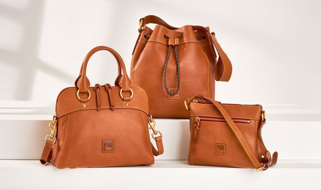 Three bags from our Florentine Collection in saddle brown leather.
