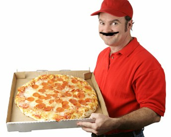 Pizza delivery man holding a pizza