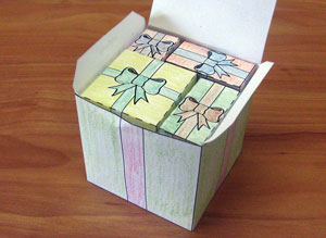 A large paper box filled with smaller rectangular and cubic paper boxes.