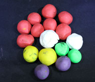 Eight red, two white, two yellow, two purple, two green balls.