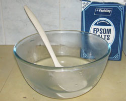 Place the 2 cups of warm water and 1 cup of Epsom salts into a microwave safe bowl. Stir to dissolve then microwave on high for 3 minutes. Stir until you have a clear solution.