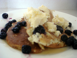 Pancakes with ice cream and blueberries.