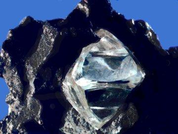 A rock containing a diamond.