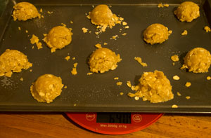 Spaced tablespoons of mixture on a baking tray.