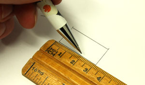Drawing a box using a ruler and pencil.