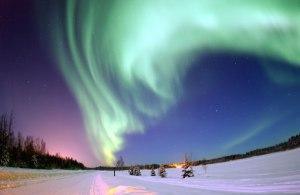 Aurora over a winter landscape.