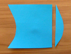 A square of paper. A curve has been cut out of the left side and put on the right.