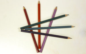 three pencils form an arrow pointing down, three form an arrow pointing left.