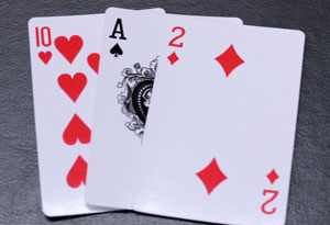 a 10 of hearts, a 2 of diamonds and ace of spades.
