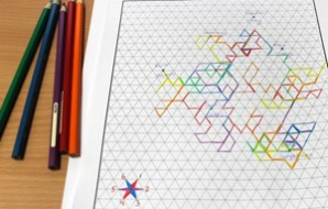 A colourful squiggly line weaves its way all over the triangular grid paper.