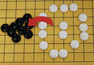 The x is occupied by a white stone, all the balck stones are removed.