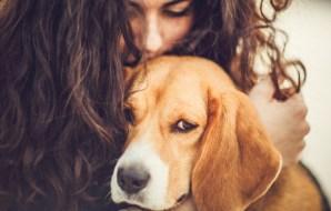 A lady hugging a dog.