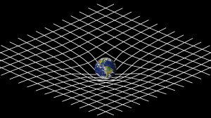 The Earth, sitting on a distorted grid that represents the gravitational field.