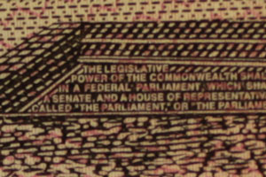 """Text saying: The legeslative power of the commonwealth... in a federal parliment... a Senate and a house of repres... ...lled """"the parliament or """"the..."""