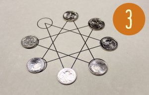 Seven coins are on seven of the eight points of a star.