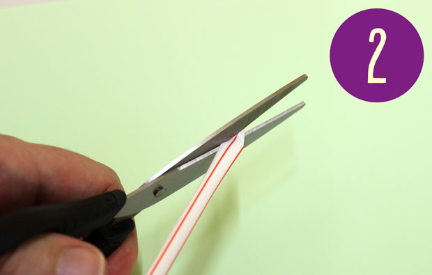 Cutting a straw with scissors.