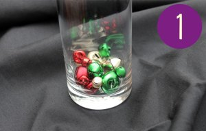 a glass containing some small bells
