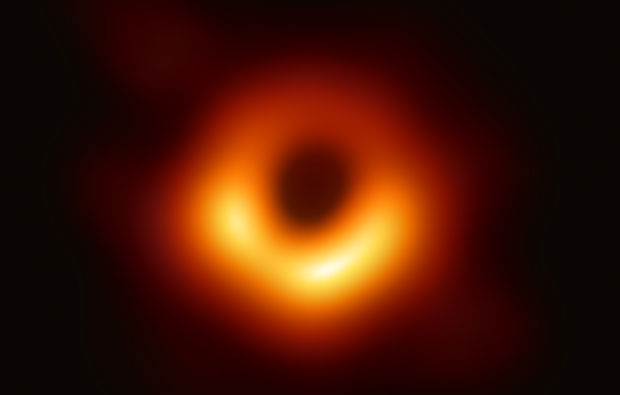 Glowing red and orange donut shape on a black background.