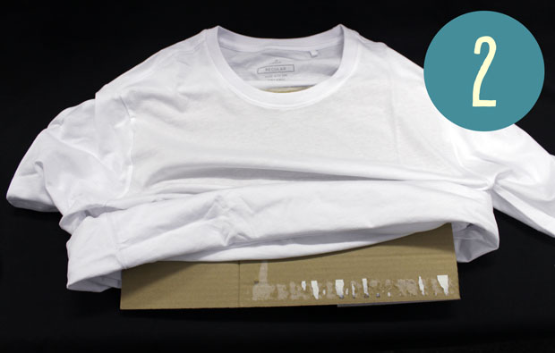 A white t-shirt with a big piece of cardboard inside it