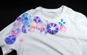 A t-shirt covered in colourful flower shapes