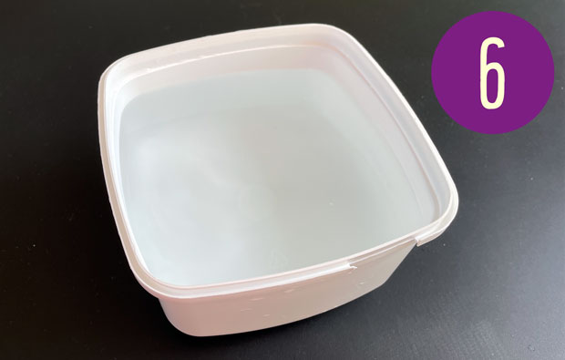 White plastic container filled with water.