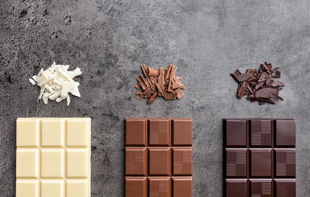 A white, a milk and a dark bar of chocolate