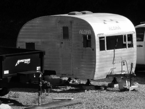 black and white photo of old camper