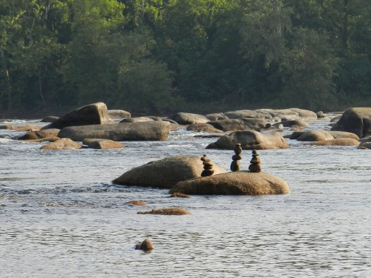 photo of rocks stacked in the James River