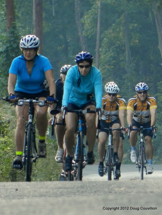photograph of an approaching group of cyclists