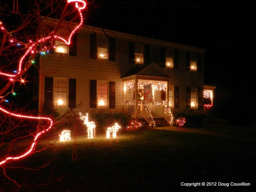 photograph of a house decorated with Christmas lights