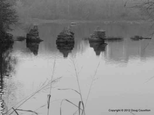 black and white photograph of old bridge pilings in the James River in Richmond, Virginia