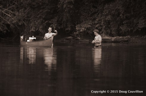 black and white photograph of two men fishing on the Rappahannock River