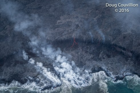 Photography by Doug Couvillion: Lava flowing into the Pacific Ocean at Hawaii Volcanoes National Park