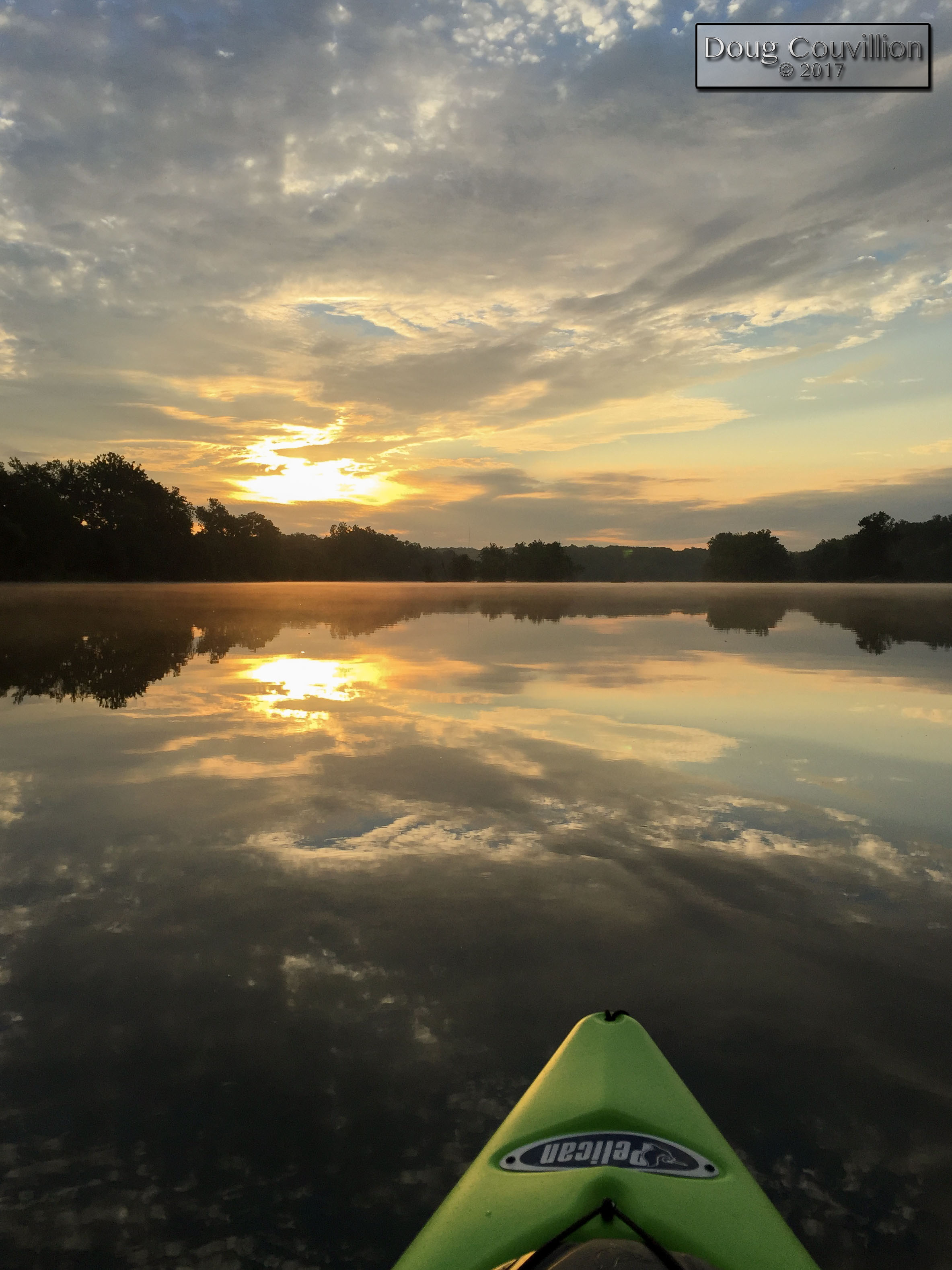 photograph of sunrise on the James River from a kayak by Doug Couvillion