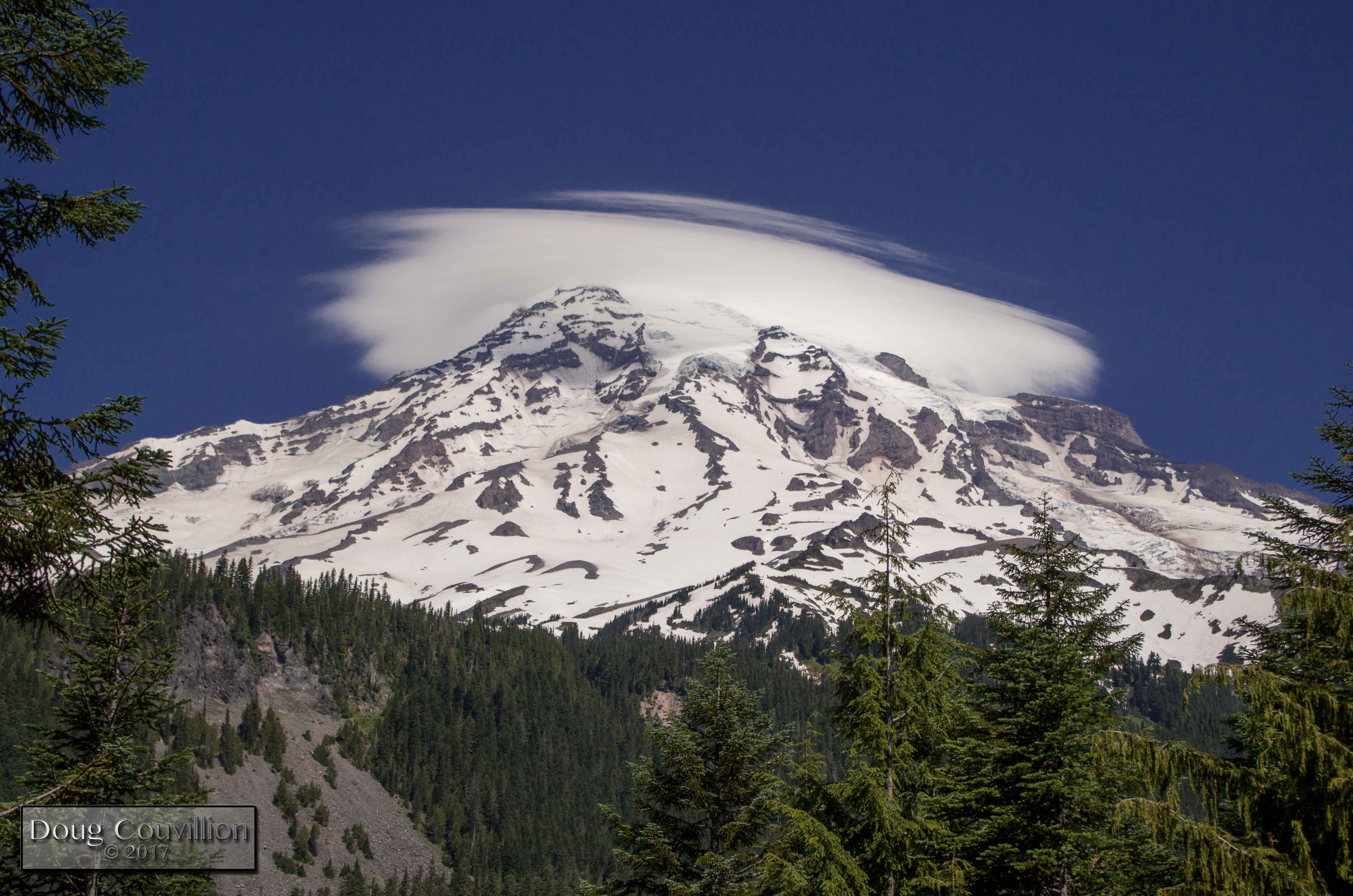 photograph of Mount Rainier with clouds around the summit by Doug Couvillion