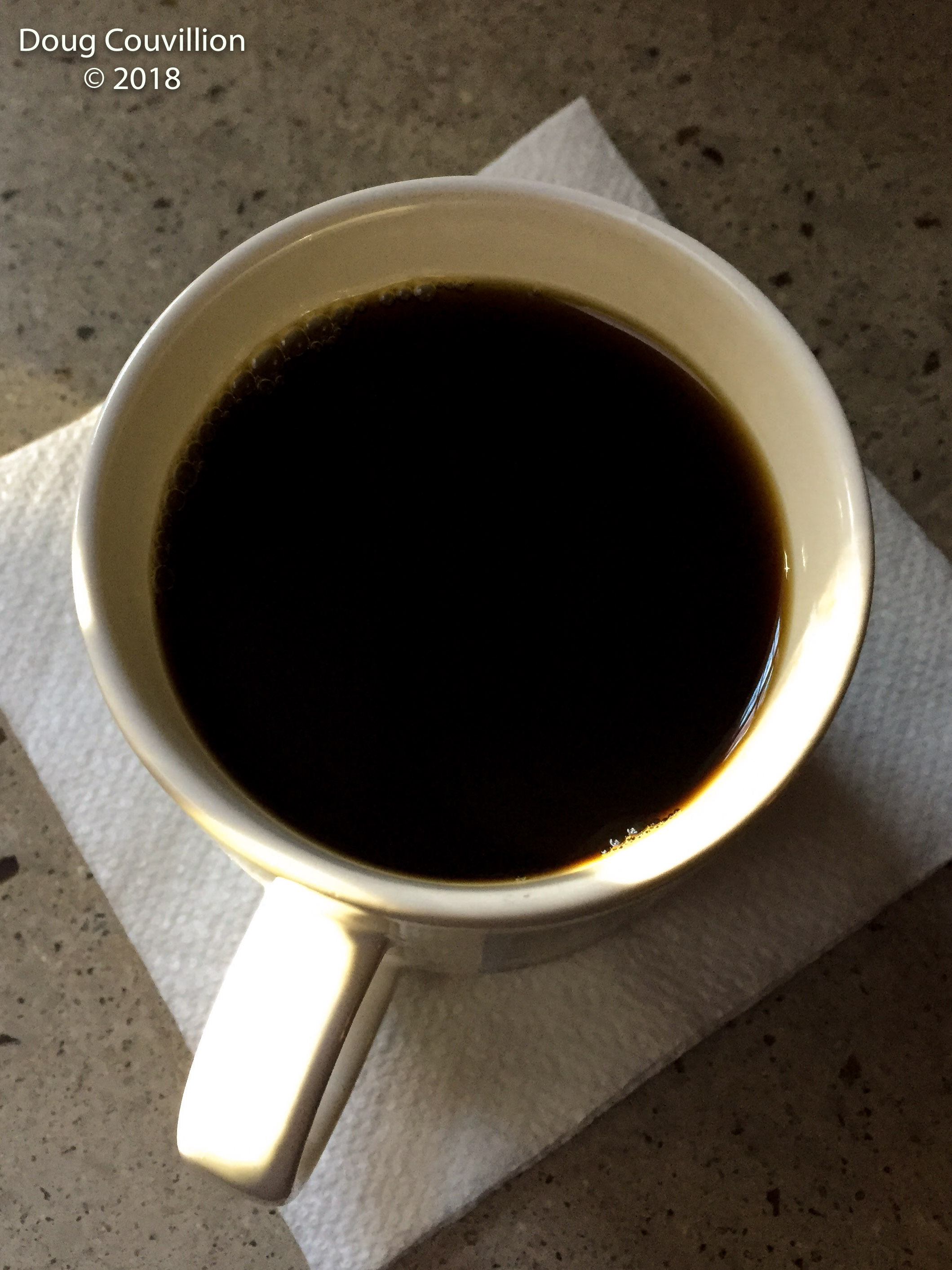 photograph of a mug of black coffee by Doug Couvillion