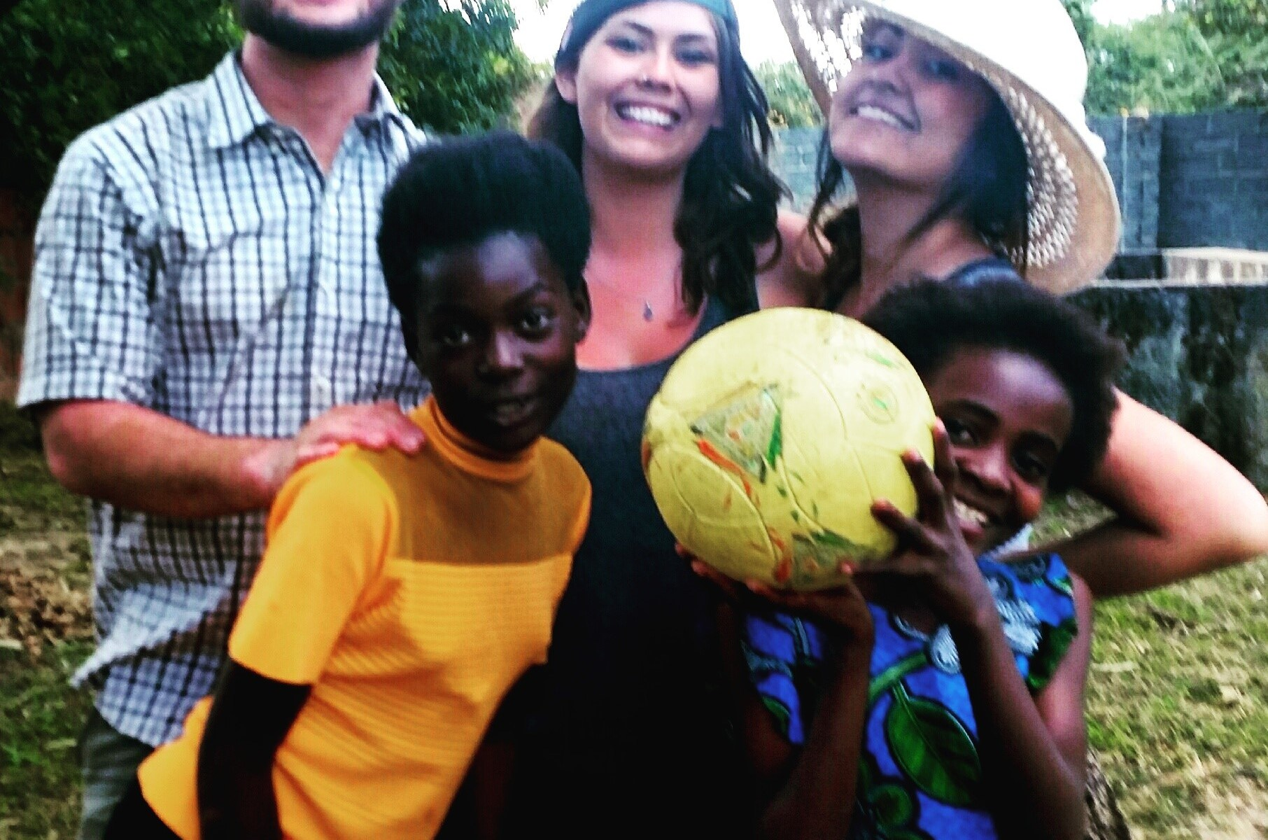 3 douglas college students with two zambian kids