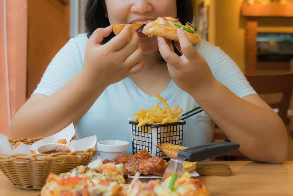 O que caracteriza a compulsão alimentar?